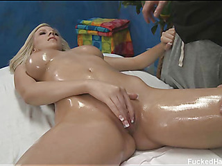 Nice-looking 18 year old gets screwed hard by her massage therapist