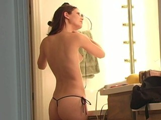 Longhaired honey is inserting banana in her luscious cookie