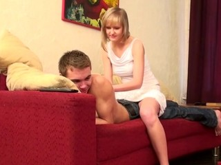 Adorable sweetheart enjoys sex on the red couch with her partner